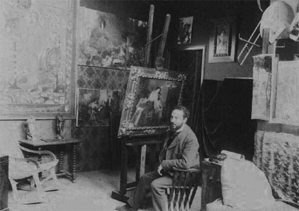 """El pintor José Garnelo en su estudio de Barcelona. En este estudio, tutelado por Garnelo, Picasso pintó, entre otras obras, """"Primera comunión"""" y """"El monaguillo""""."""